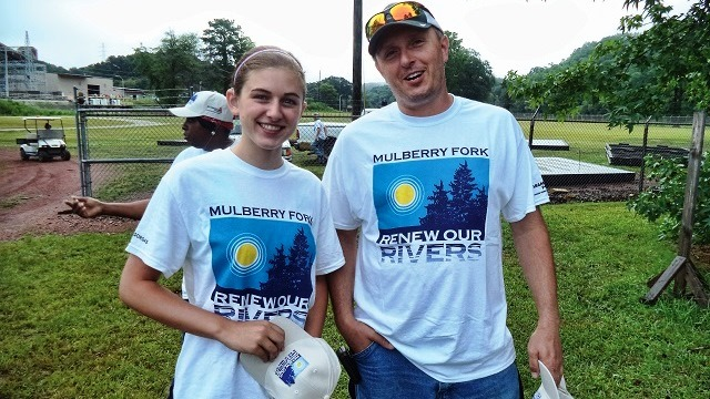 Plant Gorgas' Russell Davidson enlisted his 15-year-old daughter, Morgan, to help with this year's river cleanup, and she dove in with gusto. (Contributed)